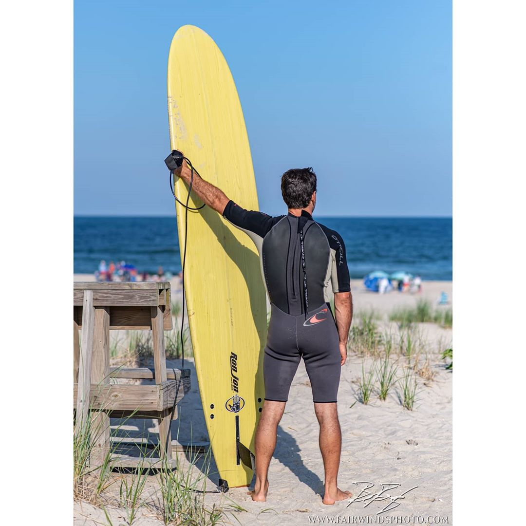 Checking the surf.  A long-boarder looks for the break… … … … #lbiphotog…