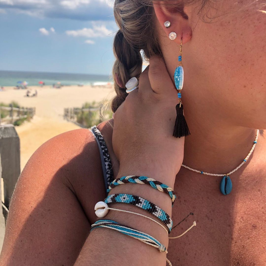 Cowrie shell jewelry all hand crafted locally on LBI in our shops.  You can pop …