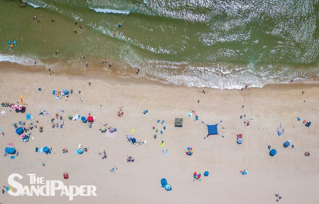 Last weekend, beachgoers in Ship Bottom (as seen from above) kept a safe distanc…