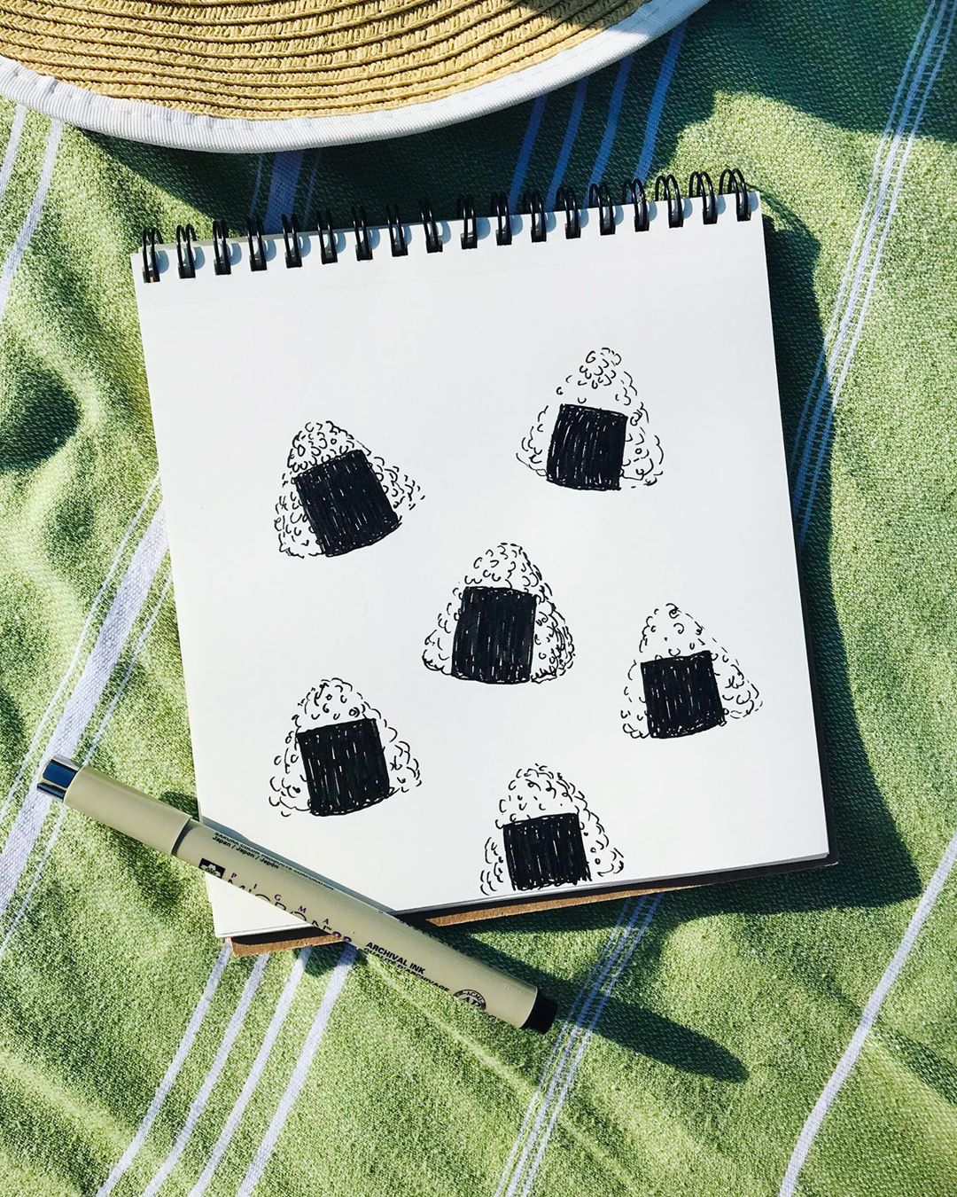 Onigiri pattern pen drawing on the beach. Day 73 #100daysoffoodillustration…