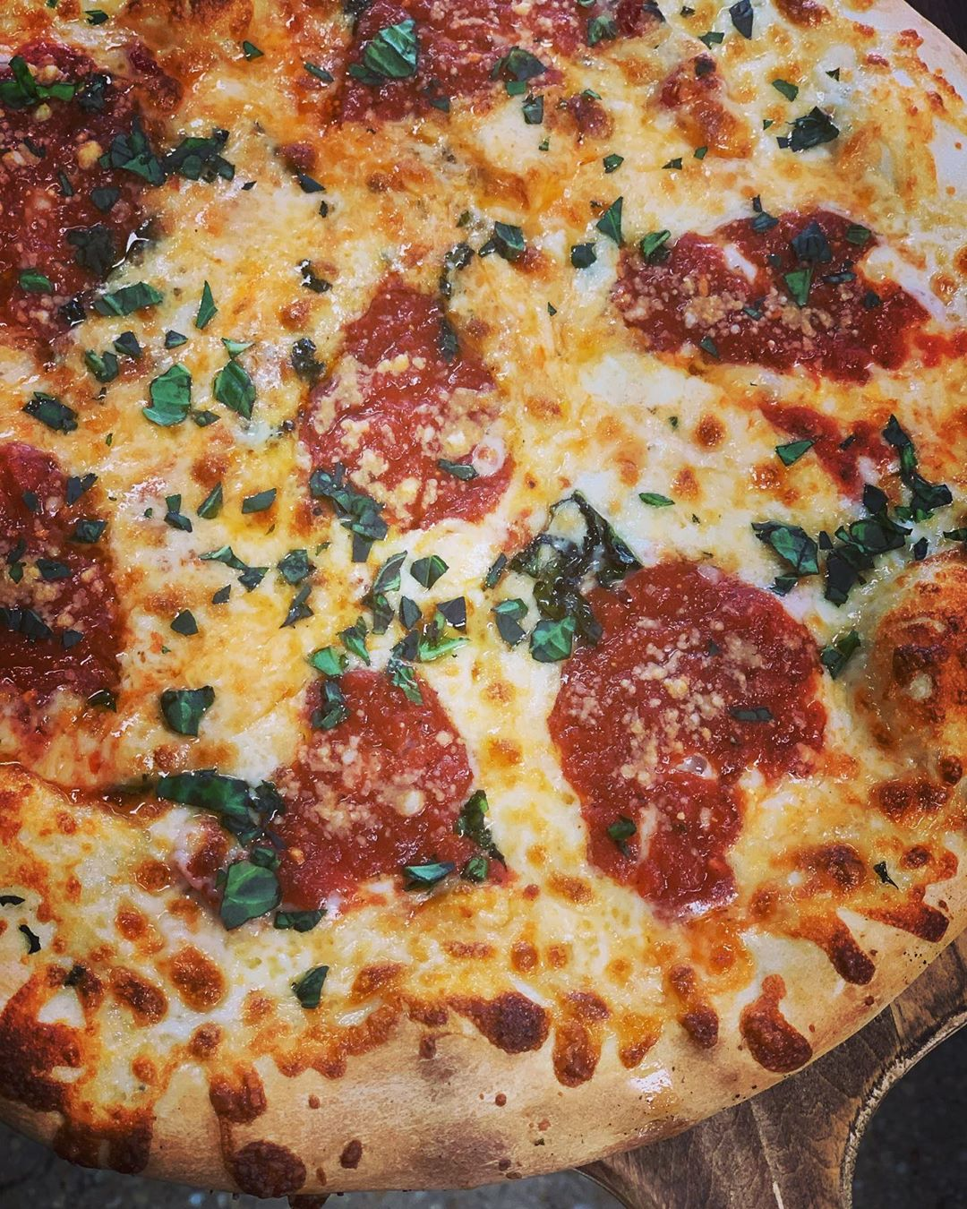 Our Pizza Margherita is topped with sun dried tomatoes, fresh basil, romano chee…