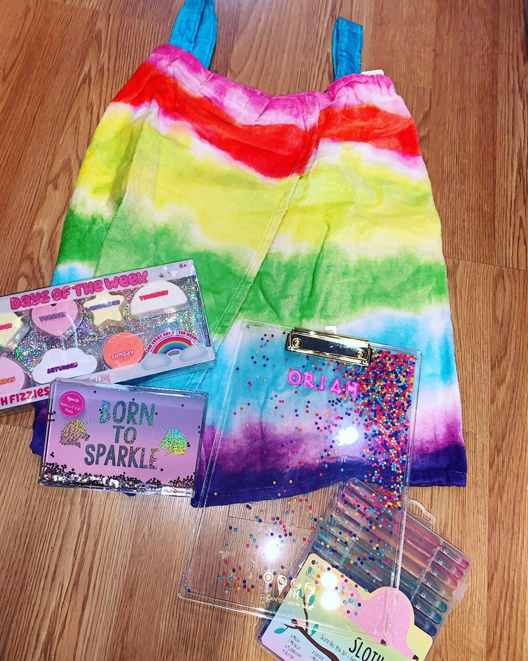 Read more about the article Rainbow spa/beach wrap with fun accessories.  Born to sparkle frame has floating…
