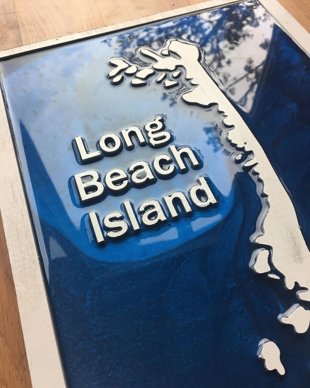 LBI Long Beach Island with a blue/black epoxy resin. This piece was cnc cut and then…