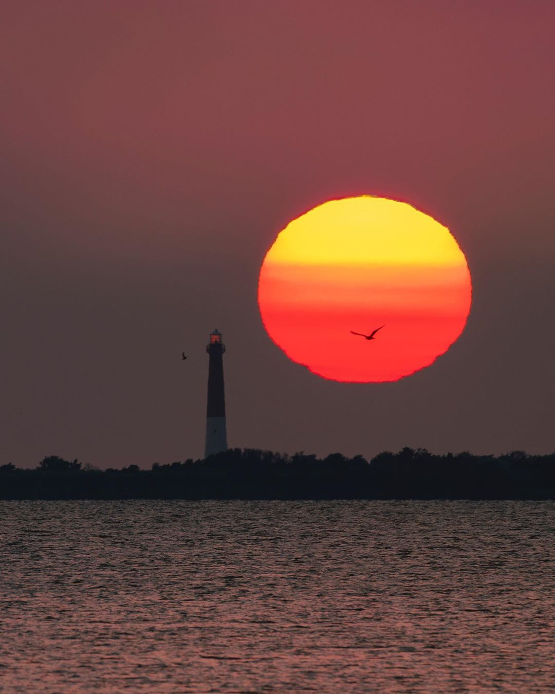 LBI This morning's sunrise behind Barnegat Lighthouse shot from 4.7 miles across the…