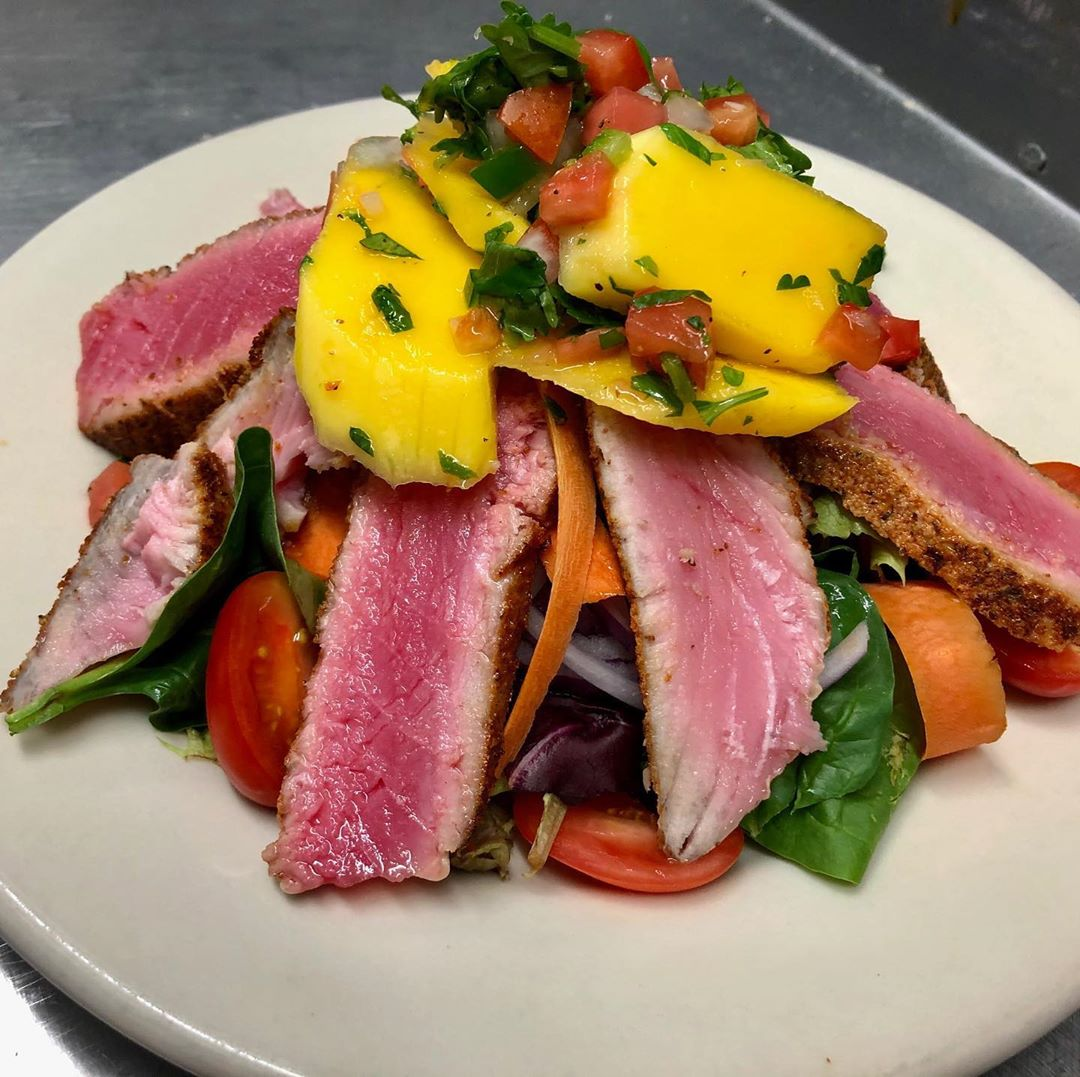 LBI Today's dinner special is Blackened seasoned Tuna Steak salad  topped with a Man…