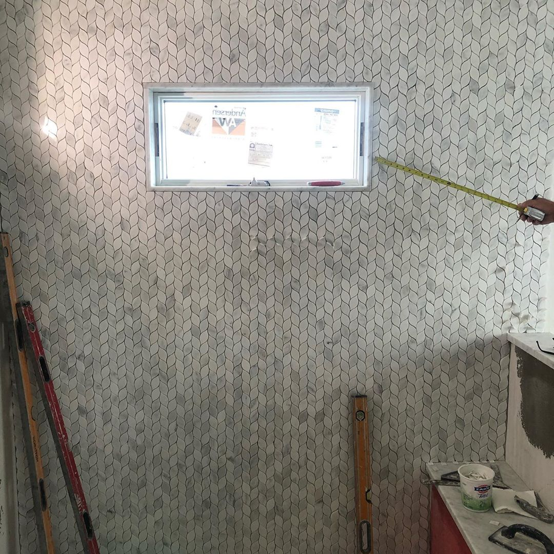 Master bathroom shower wall tile. This unique marble pattern was install by a tr…