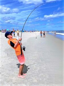 A SUNNY STANDOFF: Michael Neuner, 11, wasn't expecting a fight like this while fishing for fluke using a lightweight pole. Skillfully trying to wait out a major hookup, he fought for over 20 minutes before the line snapped. He did catch sight of a huge stingray before the break off.