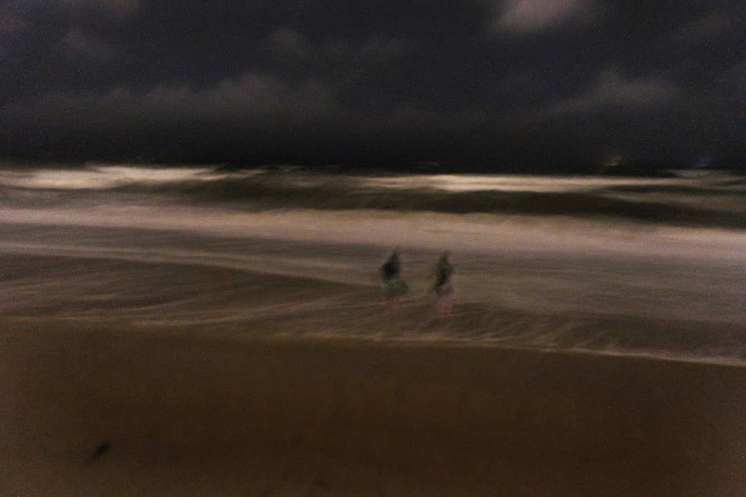 LBI Beth and Tori walking in the surf in the darkness of midnight as the Nor'easter …