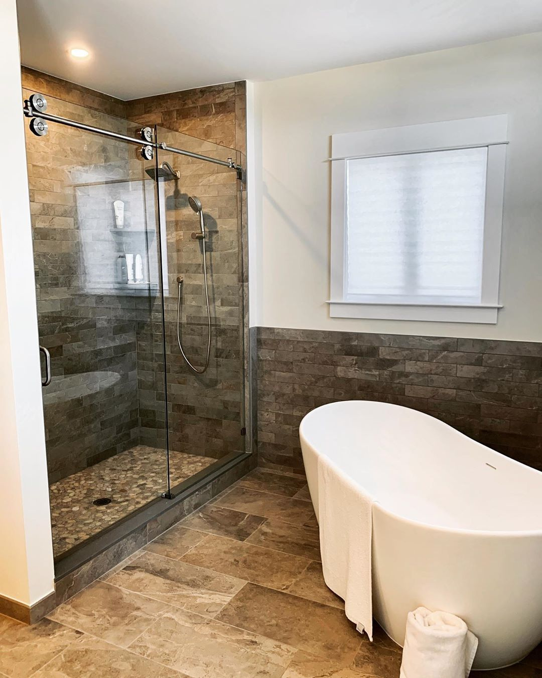 LBI Love everything about this bathroom especially the barn door slider glass enclos…