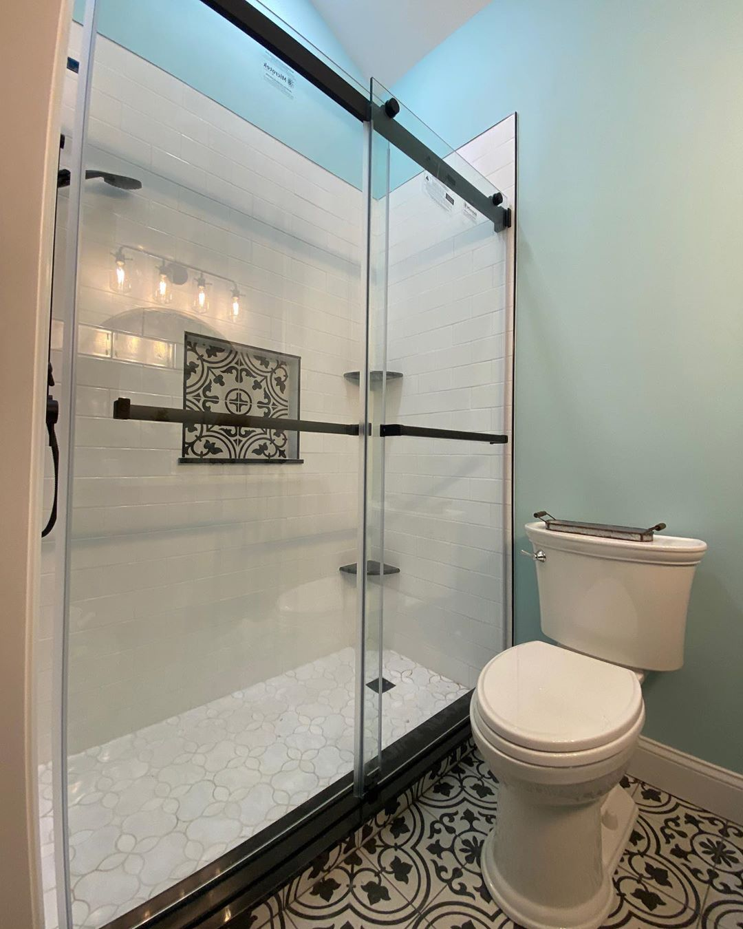 LBI  installed this beautiful shower enclosure. I love the classic black and white b…