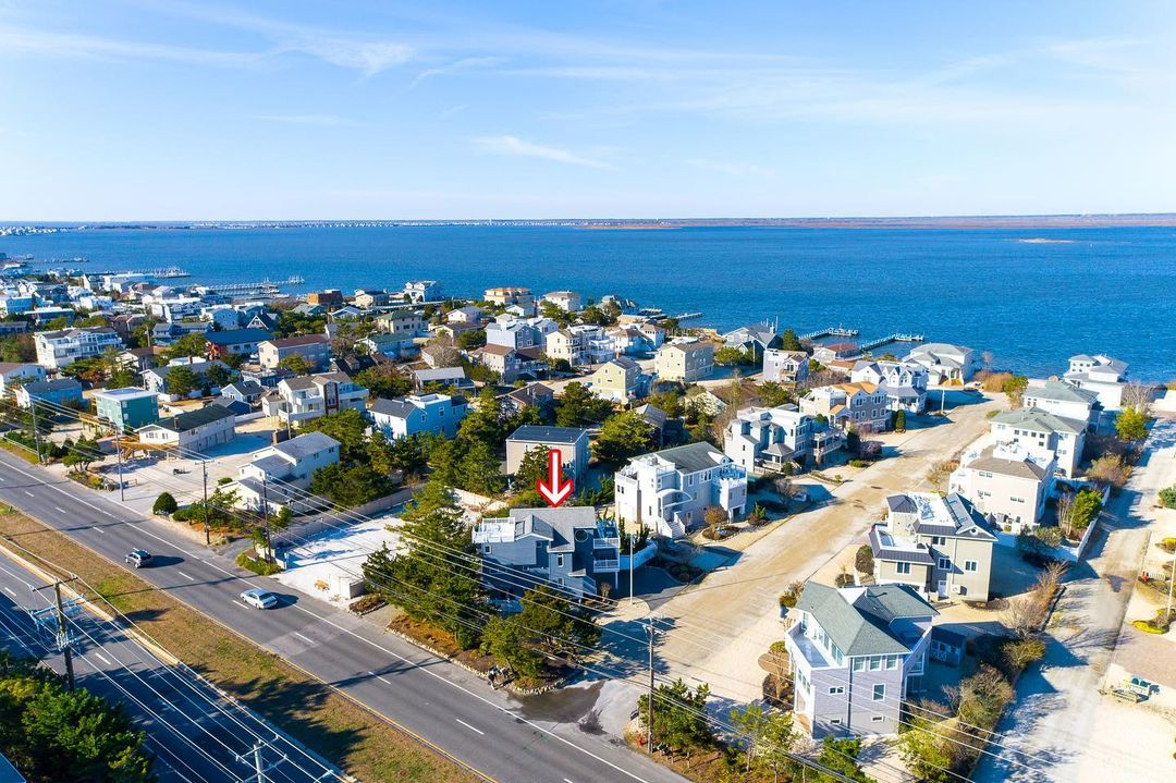 LBI Nestled on a large parcel, this well appointed, four-bedroom home has received m…