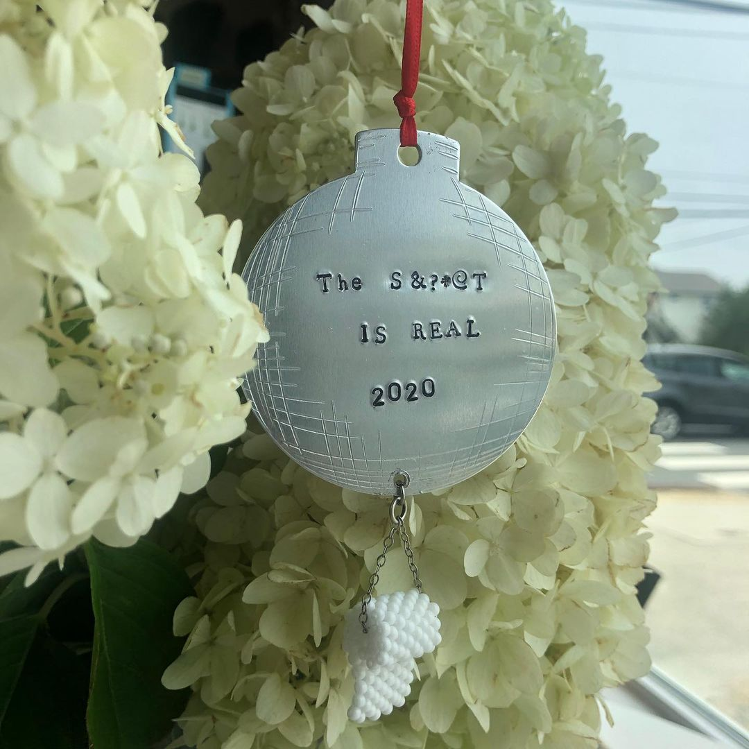 LBI Hand stamped Christmas  ornaments.  This one has a hand beaded roll of TP.  Open…