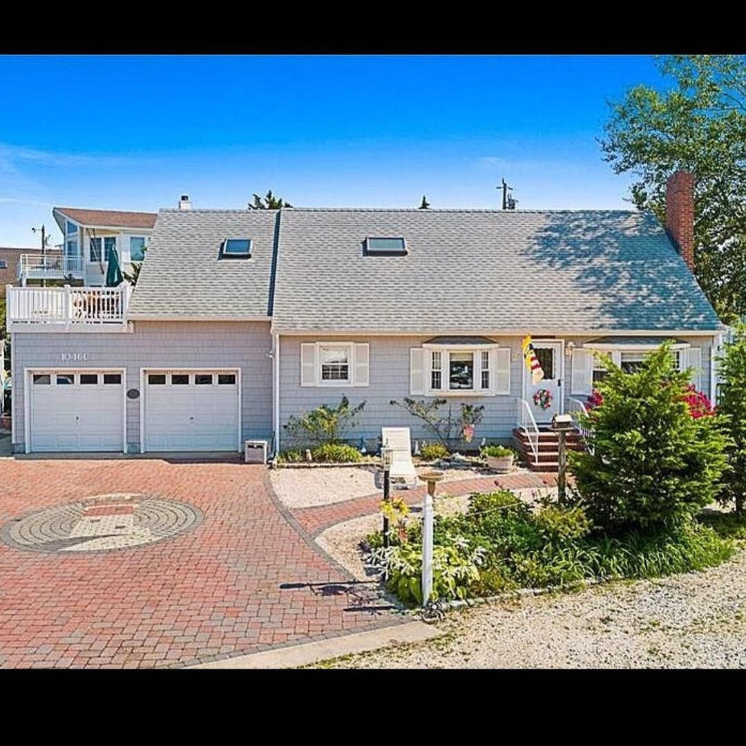 LBI $859,000 North Beach Expanded Cape Style Duplex on a double wide private lane.  …