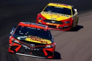 Read more about the article Martin Truex Jr. Swipes Lead on Restart, Captures First Win at Phoenix Raceway