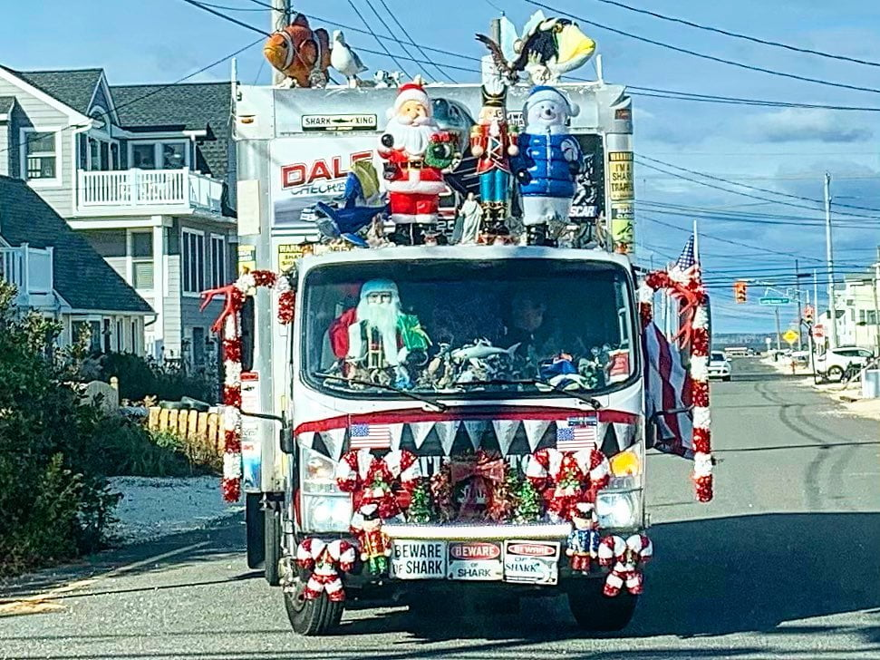 LBI Holiday things you see on LBI…Santa teen wolf surfing while also riding shotgu…