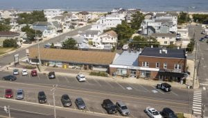 Read more about the article Surf City Strip Mall to Be Torn Down for Single-Family Homes